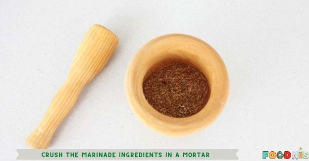 Crush the marinade ingredients in a mortar