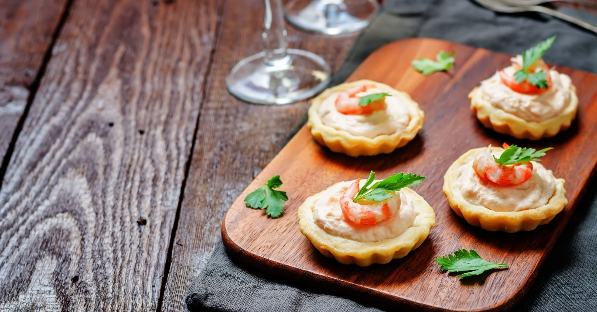 Salmon mousse tartlets and baby eels